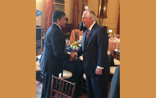 Ambassador Mohammad Ziauddin shaking hands with Secretary of State Rex W. Tillerson
